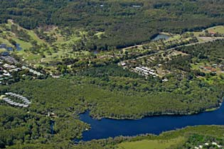 rainforest resort with Tallow lake in foreground